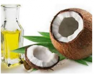 open coconut and bottle of coconut oil