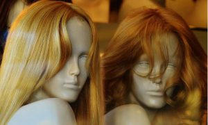 blond and brunette human hair wigs on a mannequin