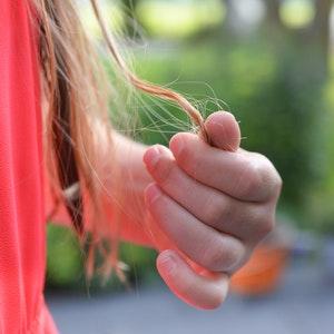 hand in hair hair loss treatment