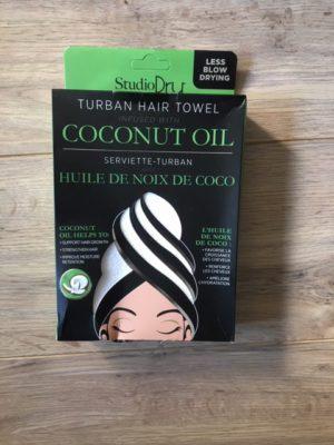 closeup of studiodry hair turban towel in box coconut oil infused